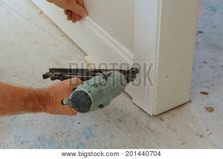 Gauge Finish Nailer man nailed slats custom house building contractor up a wall section for luxury custom house
