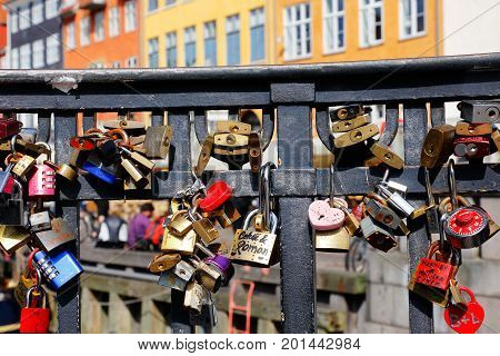 Copenhagen Denmark - August 24 2017: In the handrail at the bridge Nyhavnsbroen in Nyhavn there are locked padlocks as a symbol of love.