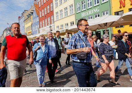 Copenhagen Denmark - August 24 2017: People walking in sunshine in Nyhavn.