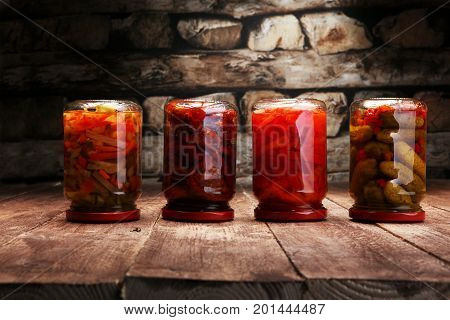 Jar With Variety Of Pickled Vegetables. Carrots, Field Garlic, Parsley In Glas. Preserved Food. Ferm