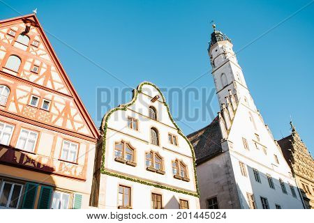 Traditional houses and a church in the main square in Rothenburg ob der Tauber in Germany. European architecture.