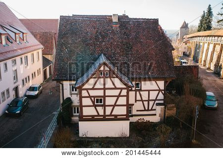 View from a high point to a beautiful street with a traditional German house in Rothenburg ob der Tauber in Germany.