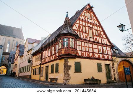 A beautiful street with a traditional German house in Rothenburg ob der Tauber in Germany. Europe.