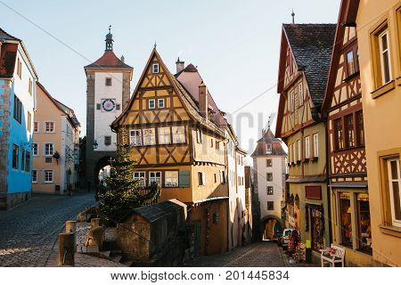 A beautiful street in Rothenburg ob der Tauber with beautiful houses in German style during the Christmas holidays. Christmas Germany without snow.