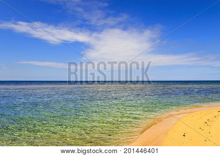Summer seascape, Apulia coast: Salento beach, Italy .It's characterized by a alternation of sandy coves and jagged cliffs overlooking a truly clear and crystalline sea.