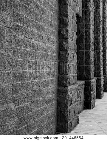Old stone textured walls of the Bowman Museum in Prineville in Central Oregon.