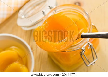 canned peach in glass jar