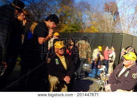WASHINGTON, DC - NOVEMBER 11, 2015: WASHINGTON, DC - NOVEMBER 11, 2015: The Vietnam Veterans Memorial Wall during Veterans Day in Washington, DC.