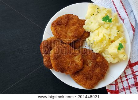 Soy Schnitzel On A White Plate On Dark Board