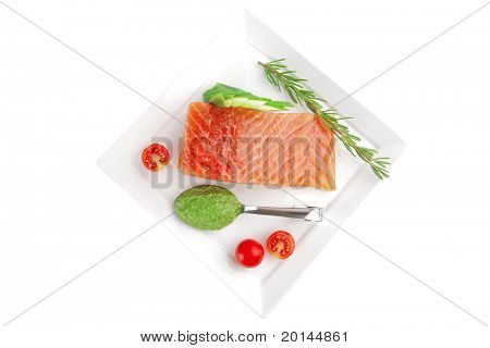 smoked salmon fillet isolated on plate with sauce