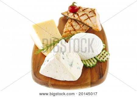 cheeses and salmon on wood over white background