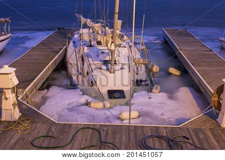 Forgotten yacht during the winter. Illinois USA.