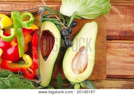 uncooked fresh vegetables prepared for use on wood