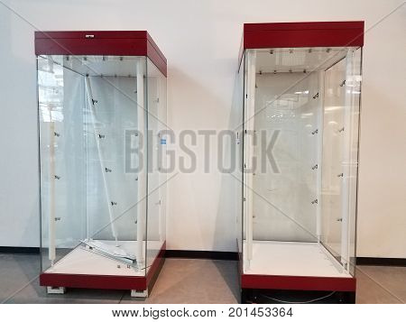 two empty red and glass display cases side by side