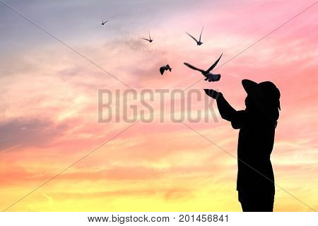 silhouette people release birds to be freedom and free