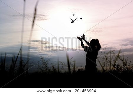silhouette people making hand as bird and release birds to be freedom and free poster