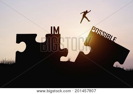 man jumping over jigsaw opposite possible shore concept as believe and faith to connect business