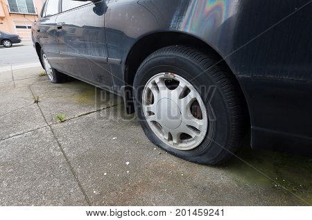 Close up Car flat tire in parking lot