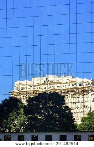 Commercial and business building with modern architecture and glass façade with reflection on the glass