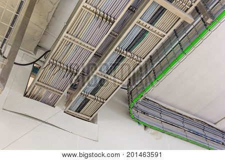 Large group of lilac utp Internet cables and electrical wiring in data center incoming electric wires
