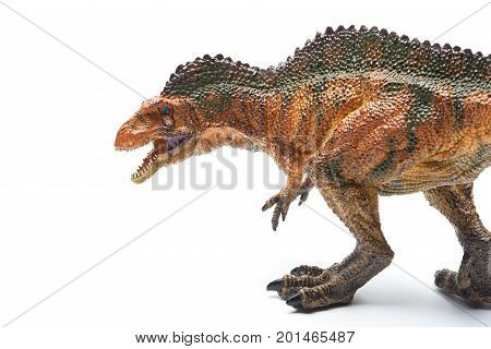 an acrocanthosaurus toy on a white background