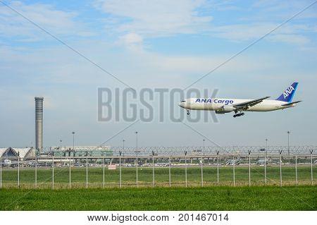 Bangkok Thailand - July 30 2017: ANA Cargo plane landing to runways at suvarnabhumi international airport in Bangkok Thailand. This airport is one of the most populated airports in the world.