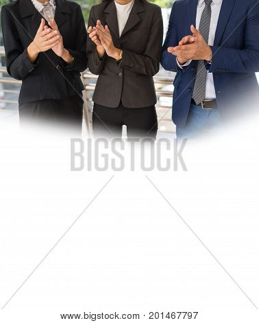 Three business people clap their hands to congratulate the signing of an agreement or contract between their companies. success and greeting concept. image card with white copy space for text.