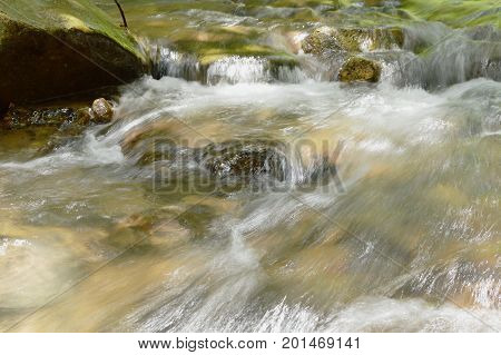 river flowing on cataract and water splashing