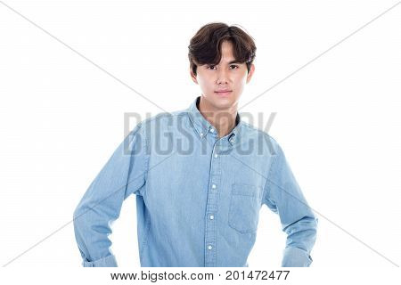 Portrait of an asian man staring seriously at the camera