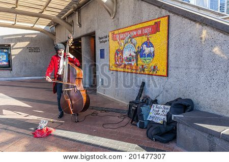 Melbourne Australia - July 29 2017: Street performer in 18th century clothes plays the cello on bright sunny day