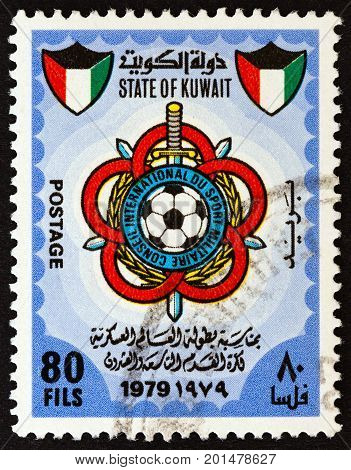 KUWAIT - CIRCA 1979: A stamp printed in Kuwait issued for the 29th International Military Football Championship shows International Military Sports Council Emblem, circa 1979.