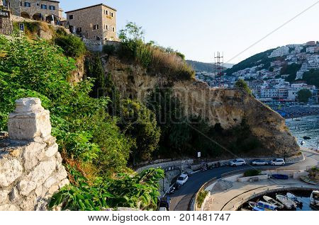 ULCINJ, MONTENEGRO - AUGUST 1, 2017: The wall of Stari Grad - old town of Ulcinj, Montenegro. City and central beach Mala Plaza on background.