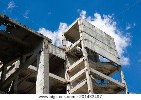 Destroyed concrete structures of an abandoned factory as the concept of economic stagnation