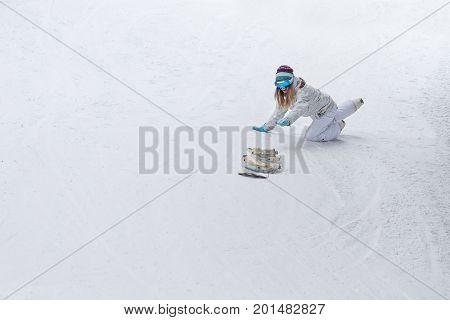 Young girl snowboarder snowboarding released from the hands down the mountain.