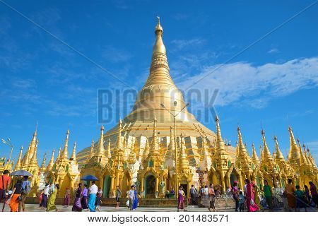 YANGON, MYANMAR - DECEMBER 17, 2016: Golden stupa of Shwedagon pagoda on a Sunny day