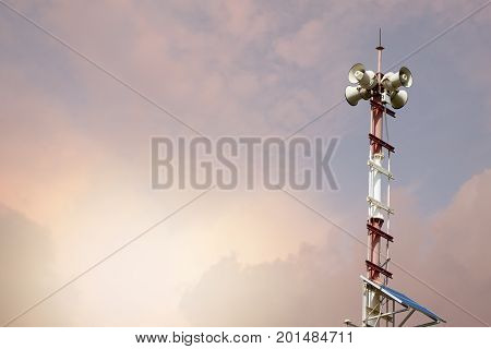 Broadcasting towers in Thailand on pink sky.