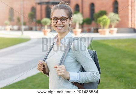 Outdoor Closeup Of Young Trendy European Student Girl In University Campus With Big Eyeglasses, Pull