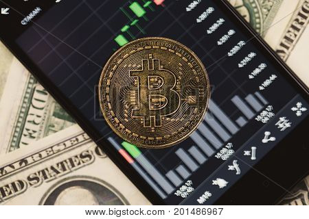 Picture of crypto money, smartphone with schedule and dollar bills