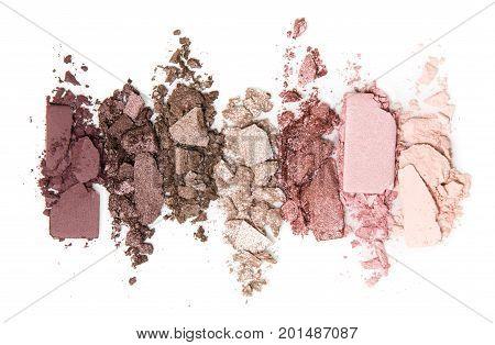 A smashed, neutral toned eyeshadow make up palette isolated on white background