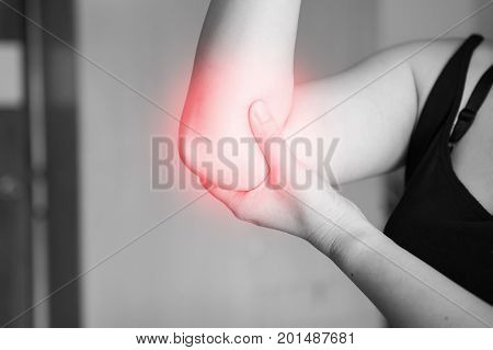 elbow pain. Women holds hand on his pain elbow sport physical injuries when working out.