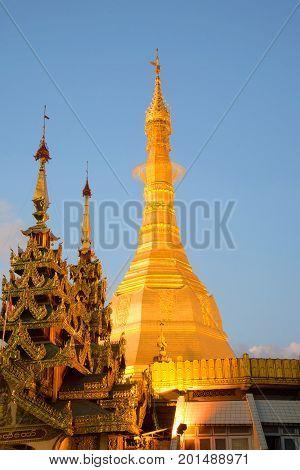 Chedi f the Sule pagoda close up in the evening twilight. Yangon, Burma
