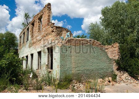 Ruined brick constructions of an abandoned factory as a symbol of economic stagnation