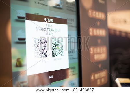 shanghai,china-May 29,2017: choice of online payment by scanning qr codes on screen in modern cafe