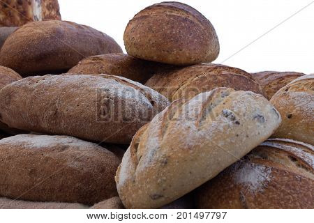 Loaves of freshly baked multigrain and sourdough bread