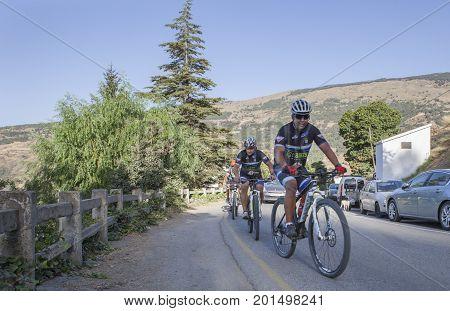 Capileira Granada - August 20th 2017: group of bikers ascending by Capileira road Alpujarras Spain