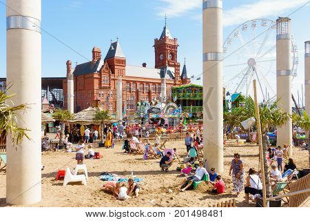 Cardiff United Kingdom - August 26 2017: Children and families are playing in the artificial beach at the urban seaside Cardiff Bay Beach fair at Roald Dahl Plass in Cardiff Bay Cardiff.