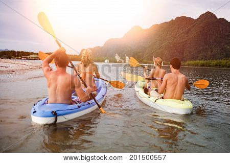 a tourist swims on kayak in the sea on background of island. Kayaking concept