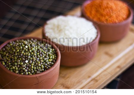 White Rice, Red Lentils And Green Peas Mache On Wooden Tray.