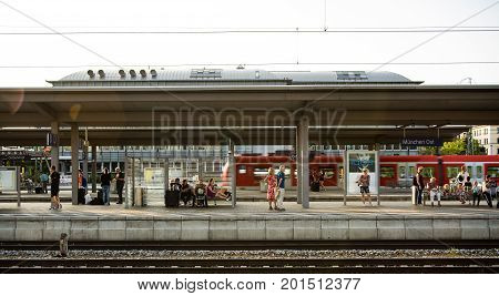 Munich,Germany-August 26,2017: People wait for a train to arrive late in the afternoon at Munich East train station