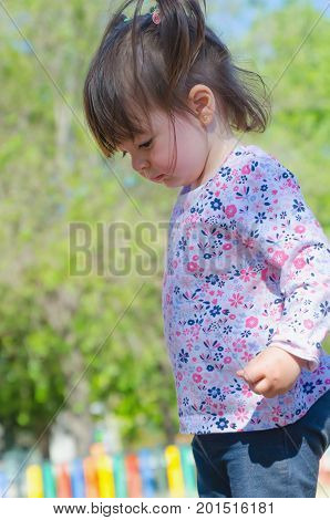 Little Girl With Pigtails In The Park